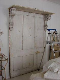 headboard made from old doors, corbels