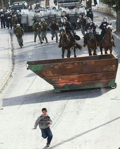 A Palestinian boy vs Israeli troops. When nearly everything is made in China, courage indeed is made in Palestine. #SaveGaza