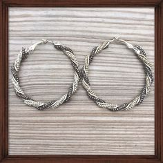 Pewter & Silver Hoops Silver and pewter tones spiral and braid together for a trendy elegant mix in these earrings. The dark and lighter metals pair well together for added shine. Never worn NWT Jewelry