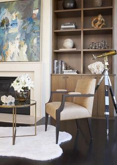 Neutral palette + built-in bookcase + fireplace design by Massucco Warner Miller  • Russian Hill Penthouse