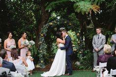 garden ceremony - photo by Allie Lindsey Photography http://ruffledblog.com/san-diego-botanic-garden-wedding