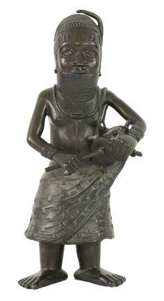 A rare Benin bronze drummer, the well-cast figure standing with bound neck, necklace and bangles, wearing a diapered cloth apron and beating a drum slung over one shoulder, 62cm £2000-3000 9th September 2014