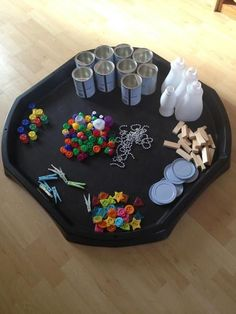 Here's an example of a math table that invites children to explore counting and capacity.