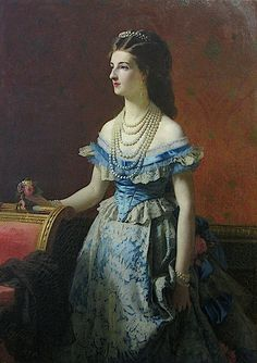 Margherita wearing a blue late crinoline era dress