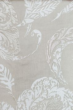 Zamindar Linen Curtain Fabric A beautiful linen curtain fabric with embroidered paisley motifs in white and silver.