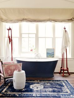 so many things to love here! Pinned for inspiration re: colors, patterns, textures, symmetry & asymmetry & decor (painting propped in window)  Trend Alert: Persian Rugs in the Bathroom via @MyDomaine