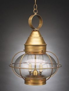 "Caged Onion Hanging Antique Brass 2 Candelabra Sockets Optic Glass by Northeast Lantern. $604.00. Northeast Lantern 2572-AB-LT2-OPT Antique Brass Hanging Lantern Dimensions: Height: 20"" Width: 14-1/2"" Length: 14-1/2"" Number of Bulbs: Maximum Wattage Per Bulb: 60 WBulb Base: Candelabra Bulbs Not IncludedGlass: Optic"