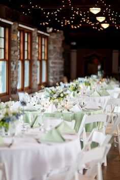 Our reception will look similar to this.  White tablecloths and chairs with a sage napkin.  Our sweetheart and cocktail tables will have a sage tablecloth with napkin color TBD (perhaps soft blue?).