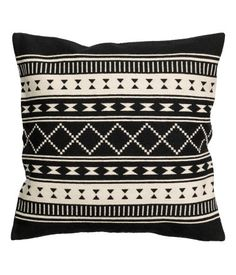 How to make easy diy graphic kilim inspired pillows by painting some standard striped pillows.