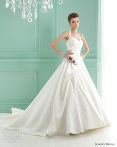 Stunning and elegant halter style wedding dress in Italian white satin and Tiffany train. Simply beautiful.
