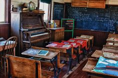 This is exactly the desks I sat in during my Catholic grade school years.  The Cloak Room was behind the blackboard! Remember???