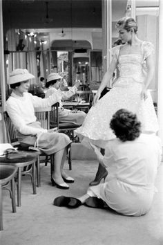 "Gabrielle ""Coco"" Chanel fitting a model in her Paris atelier"