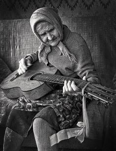 old guitar..young woman ..you are only as old as you feel....