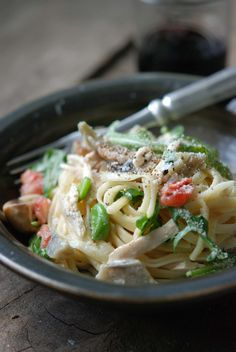 This quick pasta primavera makes use simple broth and a mess of spring vegetables tangled with fresh pasta (gluten-free in this case) and a splash of cream.