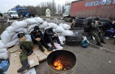 PHOTO: Crimean pro-Russian separatists blocking a road 28 February 2014 2