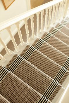 Neutral and black stairway runner with stripe borders. Stair runner: Flaxman Stone by Roger Oates and available at Mister Smith Interiors