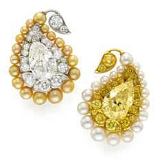 yellow diamond in diamond frame with yellow pearls