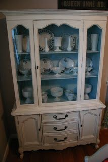 I like China cabinets that are painted an accent color on the inside