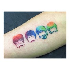 The Beatles (John Lennon, Paul McCartney, George Harrison and Ringo Starr) inspired watercolor style tattoo on the right inner arm.
