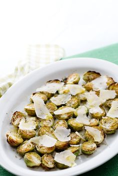 Brussels sprouts don't need to be dull and overcooked, but will taste deliciously good roasted in the oven with olive oil, rosemary and shaved parmesan cheese.