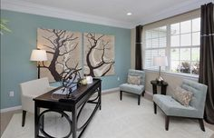 Transitional Home Office with High ceiling, Crown molding, Vaughn Upholstered Chair, Tree of Life Painting, Carpet