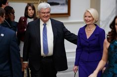 Former House Speaker Newt Gingrich and his wife Callista arrive to watch Republican presidential candidate Donald Trump during the grand opening of the Trump International Hotel- Old Post Office, Oct. 26, 2016, in Washington.
