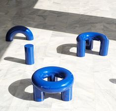 Made of thick tubes of steel, powder-coated blue to contrast pale tiled flooring, the pieces come in a range of shapes for visitors to sit on in different ways.