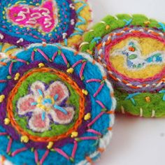 2 embroidered felted brooches.