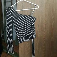 One sleeve silky top One sleeve one spaghetti strap silky stripe black and white top size Medium made of 90% polyester 10% spandex Tops Tunics
