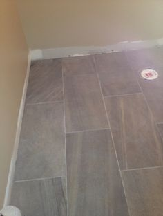 New porcelain tile, ripped out hardwood.