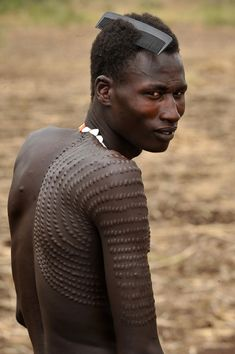 Man from the Nyangatom tribe, southern Sudan and Ethiopia. Scarification Tattoo, Dragon Tattoo Back Piece, Chris Garver, Japanese Dragon Tattoos, Mexica, African Tribes, My Black Is Beautiful, N21, African Culture