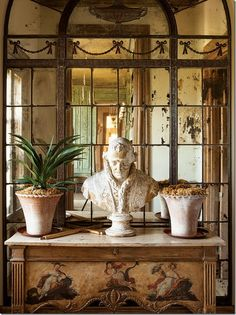 Old world vignette created by Laurie Steichen in French-designed home