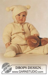 """DROPS Baby 3-6 - DROPS jacket, hat with pompoms, mittens and socks in """"Karisma"""". - Free pattern by DROPS Design"""