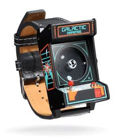 Retro Arcade Watch- Classic Collectors Arcade watch Remember those lazy summer afternoons when you'd hide out in the cool dark of the arcade with a pocket full of quarters and enough hand-eye coordination to save the universe? Relive those days when pure joy was just a high score away with ThinkGeek's Retro Arcade Watch.