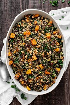 Butternut Squash and Kale Quinoa Stuffing is a fantastic vegetarian stuffing recipe loaded with tons of veggies and flavors. Mix up the typical stuffing recipe with quinoa, roasted butternut squash, and kale. This colorful   healthy dish will be a great addition to your Thanksgiving menu. Vegetarian Stuffing Recipe, Gluten Free Stuffing, Stuffing Recipes, Vegetarian Recipes, Fast Healthy Meals, Healthy Dishes, Good Healthy Recipes, Healthy Food, Healthy Thanksgiving Recipes