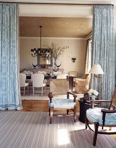 colors, curtains, ceiling-- great idea to create separation of spaces and still open.