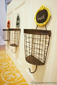 DIY Wire Basket Coat Rack - Chaotically Creative How great for wet hats & mittens! Kids Coat Rack, Coat Racks, Coat Hanger, Coat Storage, Halls, Up House, Wire Baskets, Hanging Baskets, Home Organization