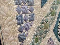 love the machine quilting! -- love the colors and the piecing is very good! Wish I knew the quilt pattern name!