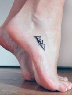 Scottish Mountains tattoo on the foot