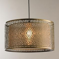 """Bubbles Metal Shade Pendant This aged brass finish bubbles design metal shade surrounds a 15"""" gold sheer organza drum shade providing a modern touch that will fit right in with eclectic, transitional, and whimsical decor. Comes ready to hang with12' of cord, bronze hardware and a 5"""" diameter ceiling canopy for a finished look. 100W max medium base socket. (18""""x18""""x10"""")"""
