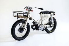 Honda Cub by Deus ex Machina The legend Honda Cub, Small Motorcycles, Custom Motorcycles, Custom Bikes, Honda Bikes, Honda Motorcycles, Ex Machina, Moto Bike, Bike Design