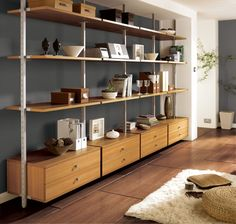 Captivating Shelving Unit Design Idea with White Steel Frames and Brown Wooden Shelves and Some Wooden Drawers Below also Installed in Living Room Idea