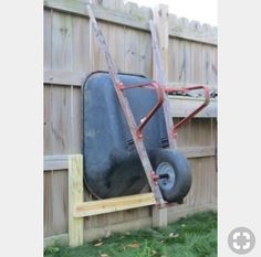 Shed Plans - I wanted to raise my wheelbarrow up to make it easier to mow around. Here is a quick way to store a wheelbarrow next to a fence. - Now You Can Build ANY Shed In A Weekend Even If You've Zero Woodworking Experience! Garage Shed, Garage Tools, Small Garage, Garage Lift, Garage House, Backyard Projects, Garden Projects, Wood Projects, Outdoor Projects