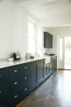'Pantry Blue' cupboards with our 'Bella Brass' cup handles and knobs.