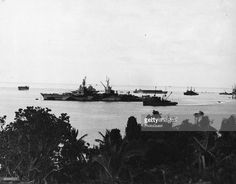 As seen from Orote Peninsula, a view of the USS Indianapolis in Apra Harbor, Guam, August 10, 1944.