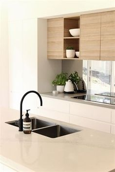 Get the lowdown on stone, concrete, Caesarstone laminate, stainless steel kitchen benchtops and more, to help you find out how to choose the best surface for your home. Basic Kitchen, New Kitchen, Kitchen Sink, Kitchen Island Bench, Kitchen Cabinets, Black Kitchens, Home Kitchens, Kitchen Black, Modern Kitchens