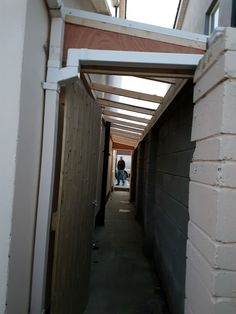 Are you considering building a new garden shed. This roof over side passage could be the answer. A strong durable lean to roof with doors and gutters fitted. That is basically it, the dividing wall can be used for shelves, hooks and hangers. Lean To Roof, Lean To Shed, Shed Shelving, Curved Pergola, Outdoor Pergola, Side Porch, Bike Shed, Backyard Sheds, Pergola Lighting