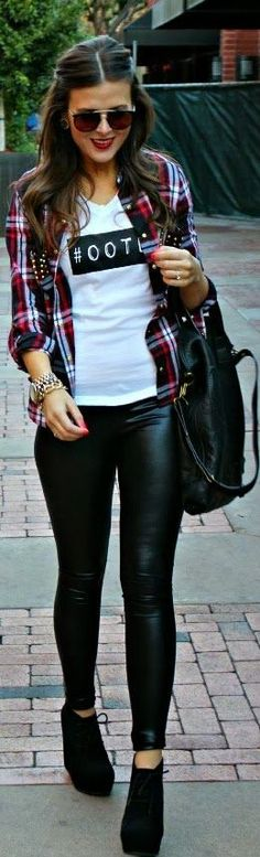 white graphic tee + plaid printed button up + black leather pants + black boots + black bag + sunglasses