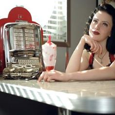 Chrome and vintage appliances help create the 1950s diner charm.