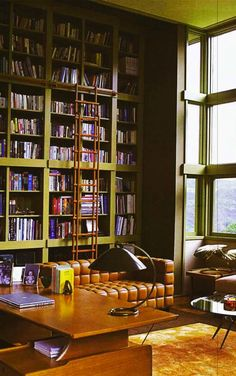Tall ceilings and a sliding ladder allow bookshelves to reach new heights.